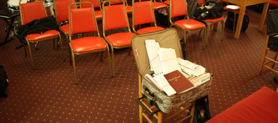 Collection of Sacred Harp songbooks and a Church Hymnal, All items in a rolling suitcase